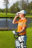 Man golfer watching into rangefinder Stock Photos