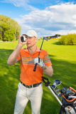 Man golfer watching into rangefinder Royalty Free Stock Photography
