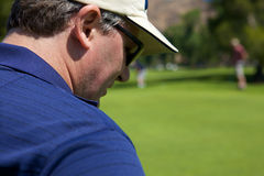 Man Golfing Stock Photography
