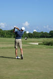 Man Golfing. Man on beautiful golf course in Cozumel Mexico golfing Stock Photography