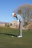 Man Golfing. Man putting on green in Arizona in the winter time Royalty Free Stock Images