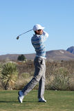 Man Golfing. Man swinging the golf club on a golf course in Douglas Arizona Stock Photography