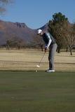 Man Golfing. Man putting on green in Arizona in the winter time Stock Photo