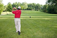 Man Golfing. On a summer day stock images