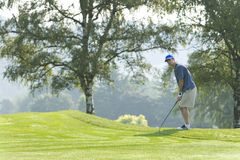 Man Golfing - horizontal Royalty Free Stock Photos