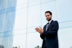 Man with good feeling standing near office building Royalty Free Stock Image
