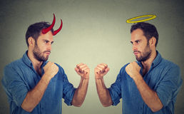 Man good fighting evil Stock Images