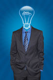 The man with the good ideas. Relaxed businessman with a light bulb instead his head. Concept: Having a good idea and being creative Stock Image