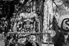 Photo outdoor of a man with a good torso with a shovel and a cowboy hat Royalty Free Stock Photos