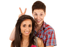 Man goofing around behind his girlfriend Stock Photo