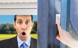 Man gossiping through the window Stock Image