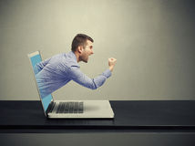 Man got out of the laptop Stock Images