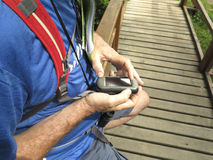 Man with gps. In hands planning hiking route Stock Photos