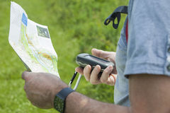 Man with gps and plan stock photography