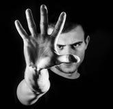 Man grabb, hipster och att göra stopptecknet som visar den mest gest rejective handen fotografering för bildbyråer