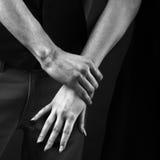 Man grabbed. Aggression arm monochrome stock photos