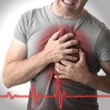 Man grabbing chest in pain royalty free stock images