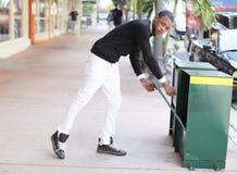 Man grabbing the newspaper Royalty Free Stock Photo