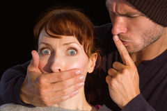 Man grabbing woman around mouth Stock Image