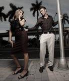 Man grabbing a woman on the street Royalty Free Stock Photos
