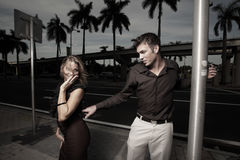 Man grabbing a woman on the street. Young businessman grabbing a sexy woman on the street Stock Images