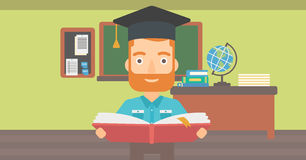Man in graduation cap holding book. Royalty Free Stock Images