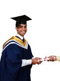 Man in graduation gown. Portrait of a young Indian man wearing graduation cap and gown, receiving a diploma Royalty Free Stock Image