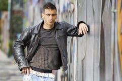 Man in graffiti background Royalty Free Stock Photos