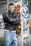 Man in graffiti background Stock Image