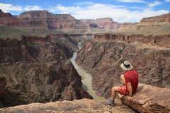 Man on Grand Canyon overlook Royalty Free Stock Photo