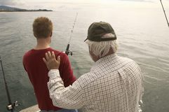 Man With Grandfather Fishing On Yacht Royalty Free Stock Photo