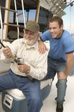 Man With Grandson Fishing Together Royalty Free Stock Photography
