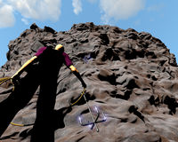 Man grapple cliff. Man about to climb over a hurdle Stock Image