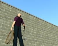 Man grapple wall. Man about to climb over a hurdle Royalty Free Stock Image