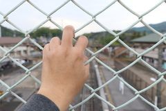 Free Man Grasp The Bar Of Cage With The Defocus Of City Background Stock Image - 108898761