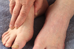 Man grasping foot Stock Image
