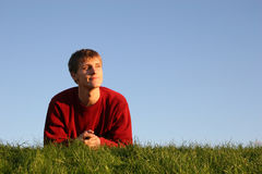 Man on grass Stock Photo