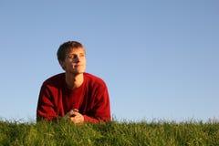 Man on grass stock photo
