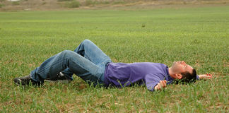 Man on grass. Man on green grass Stock Images