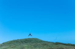 Man on grassy hill Stock Images
