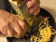 Man  grating cheese Royalty Free Stock Image