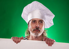 The man with gray beard in a sailor suit and hat chef the billboard  Stock Photo
