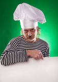 The man with gray beard in a sailor suit and hat chef the billboard  Royalty Free Stock Photos