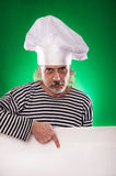 The man with gray beard in a sailor suit and hat chef the billboard  Stock Photos