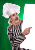 The man with gray beard in a sailor suit and hat chef the billboard  Royalty Free Stock Images