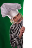 The man with gray beard in a sailor suit and hat chef the billboard  Stock Image