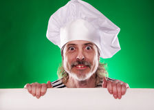 The man with gray beard in a sailor suit and hat chef the billboard  Royalty Free Stock Image