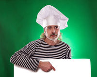 The man with gray beard in a sailor suit and hat chef the billboard  Royalty Free Stock Photography