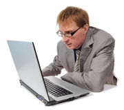 Man and gray laptop Stock Images