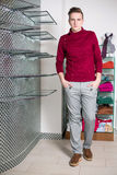 The man in gray pants and a red sweater Royalty Free Stock Photos